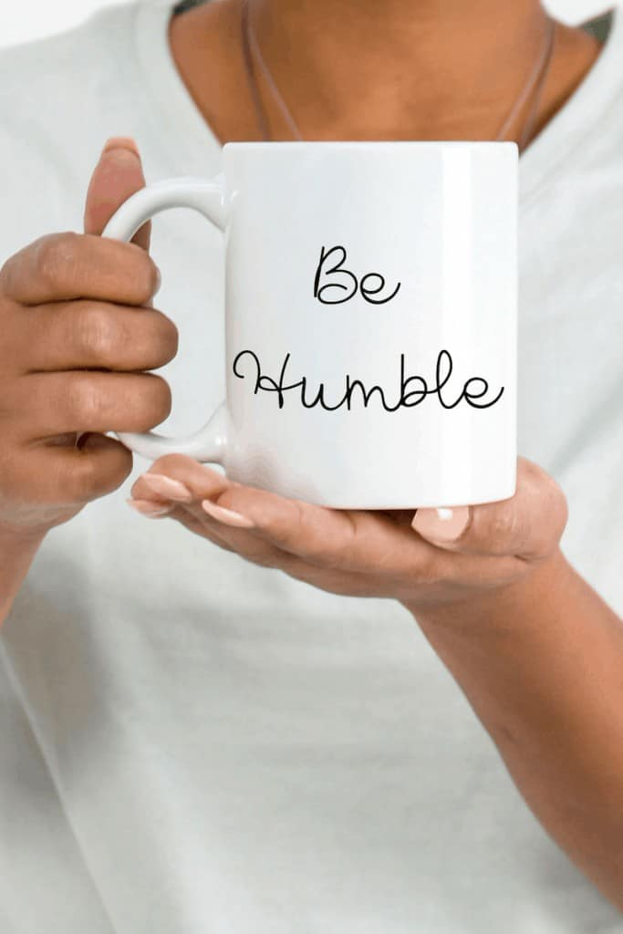 photo of woman holding mug titled 'be humble'