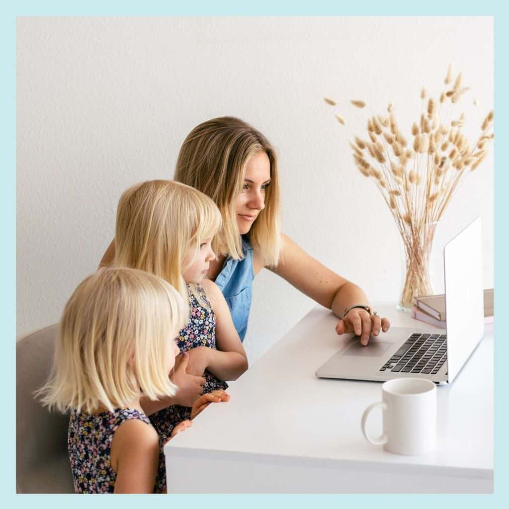 mom kids working at desk on computer